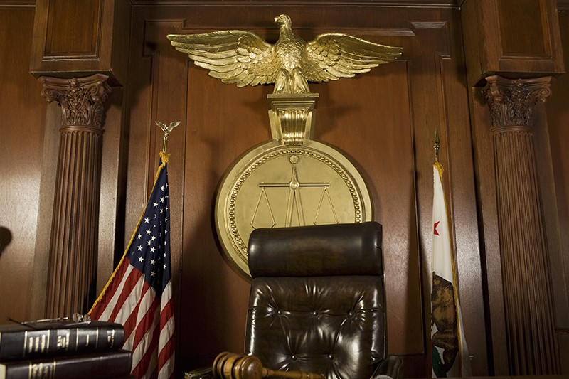 A photo of a judge's bench in a courtroom