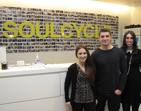 Photo of the CEO of Soulcycle with two law student interns